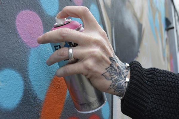 Cally Trench, Left hand of Cize One with 'Urban Authenticity' on the wall of Swanley Mills Tattoos, 27th April 2019